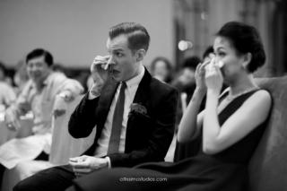 bride and groom weep